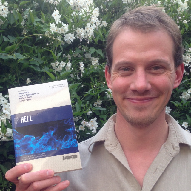 "Alex holding his copy of ""Four Views on Hell: Second Edition"""