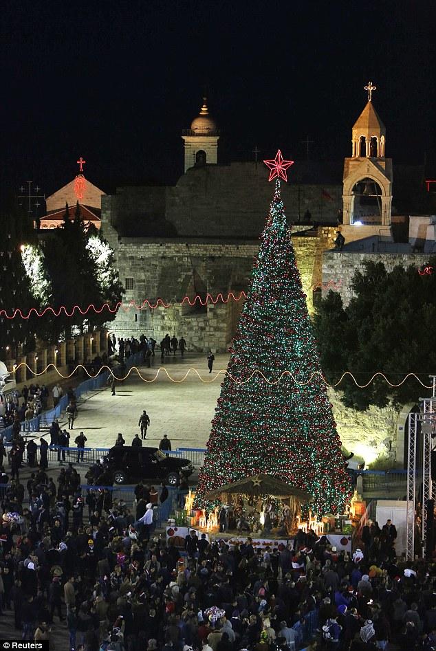Crowds visit Christmas tree & nativity in Bethlehem
