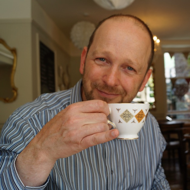Robin Parry holding a teacup